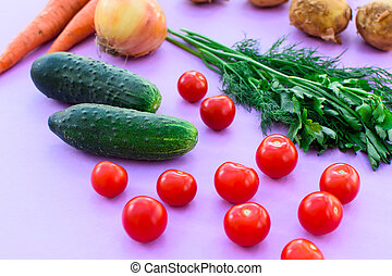 Different vegetables on purple background.