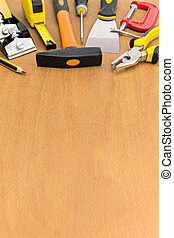 Different work tools on wooden background