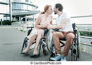 Differently abled couple spending time with pleasure
