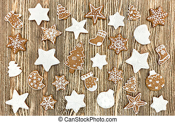 differently shaped homemade gingerbread cookies on rustic wooden background