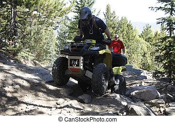 Difficult ATV Trail - Helmeted ATV rider carefully ...