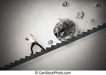 Concept of difficult career of a businessman with falling rocks