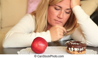 Difficult choice between healthy or junk food, diet concept...