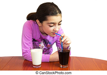 Dilemma - milk or cola. The young girl easy chose. Isolated on white.