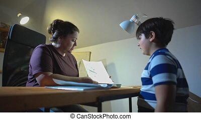 Difficult Teenager Consulting a Child Psychologist. Work is being done on the interpretation of the drawings made by the teenager. Psychology. Psychotherapy. Neurology.