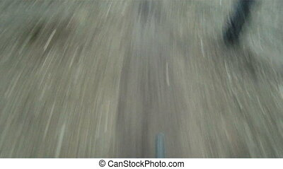 Difficult track - Biker surmounting a difficult track during...