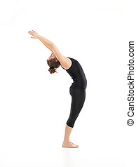 back bent yoga pose, demonstrated by young woman, dreesed in black, on white background