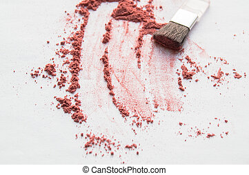 Diffuse blush or beige brown colored loose face powder and makeup brush isolated on white background. Top view