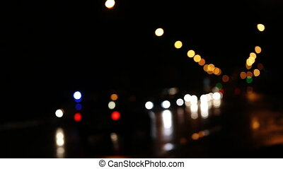 Diffused background with blurring lights of cars on the road of a big city.