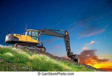 Digger at sunset - Digger on hill with grass and flowers at...