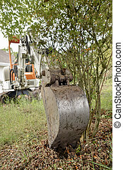 Digger being used in a garden
