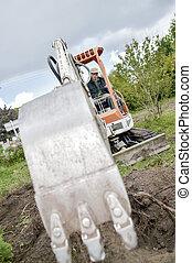 Digger in a garden