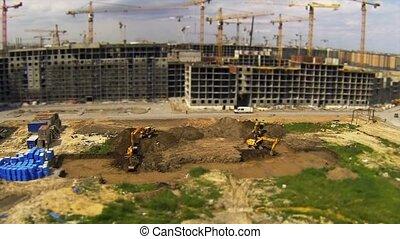 digging - HD1080: excavators dig foundation pit at a...