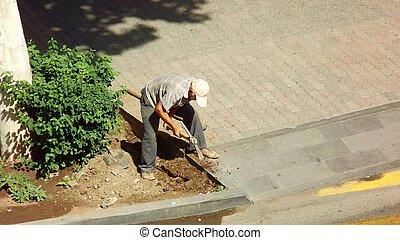Digging man