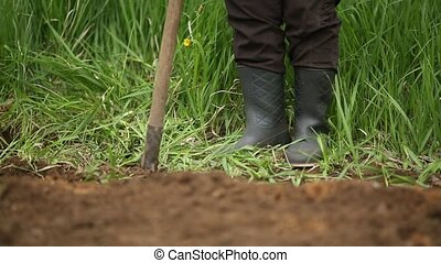 Digging spring soil with shovel. Close-up.