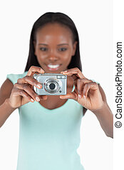 Digi cam being used by smiling woman