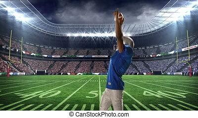 American football player celebrating
