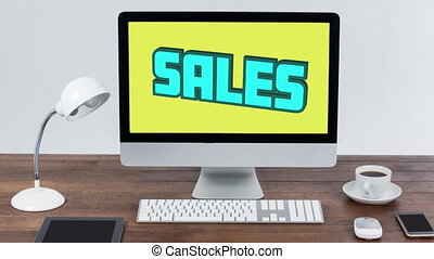 Digital animation of blue sales text bouncing against yellow background on computer screen on wooden surface. global retail business concept