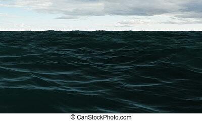 Choppy blue ocean under cloudy sky