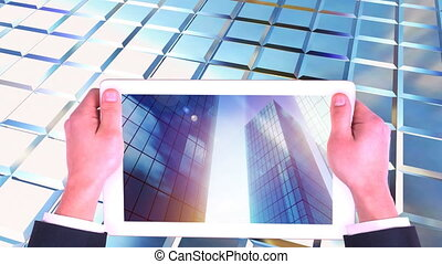 Digital animation of digital tablet screen showing high-rise commercial buildings 4k
