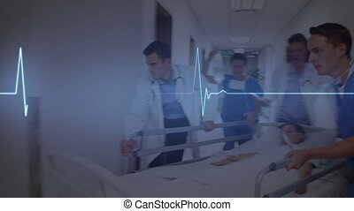 Digital animation of glowing blue heart rate monitor against male doctor and team of medical professionals wheeling a patient at hospital. medicine research science concept