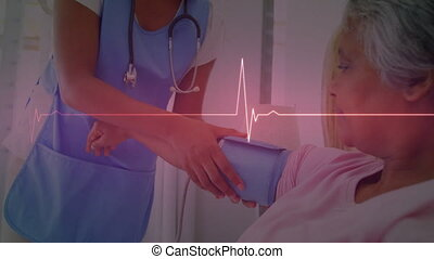 Digital animation of heart rate monitor against female medical professional checking blood pressure senior female patient in hospital in bed. medicine research science concept