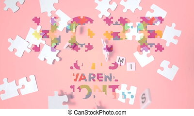 Hope and Autism Awareness Month text over jigsaw puzzle - ...