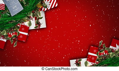 Digital animation of snow falling against christmas gift boxes and decorations on red background