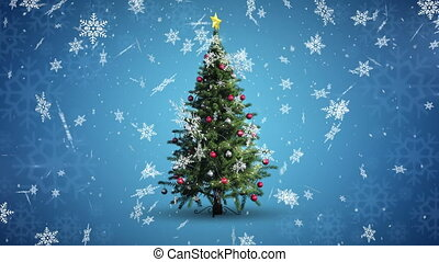 Digital animation of snow flakes falling over christmas tree on blue background