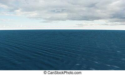 Still blue ocean under sky
