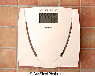 Digital bathroom scale with tiles in background