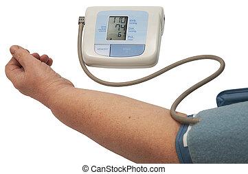 digital blood pressure monitor on a white background