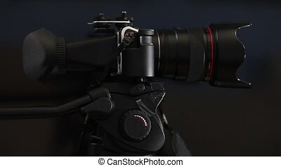 Digital Camcorder with Viewfinder on a tripod close to