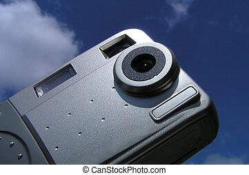 Digital camera against blue sky