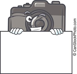 Digital camera cartoon character with funny face hides behind a board