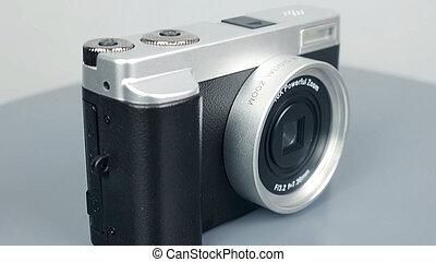 Digital camera on desk, isolated