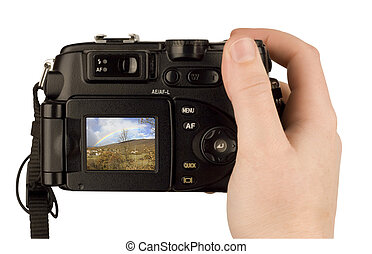 Digital Camera photo in a hand isolated on withe background. lcd screen and background can be easily edited