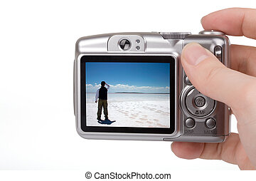 Digital Camera - Digital camera in a hand. Photo on screen...