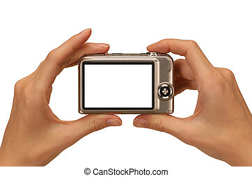 digital camera - female hands taking picture with a compact...