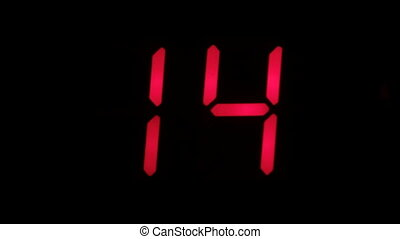 Digital clock countdown from sixteen to zero. Digital timer in red color over black background.
