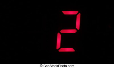 Digital clock countdown from zero to sixteen. Digital timer in red color over black background.