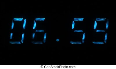Digital clock shows time of 06 hours 59 minutes to 07 hours 00 minutes