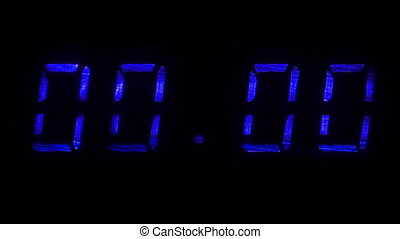 Digital clock with fluorescent display shows 00:00 in yellow...