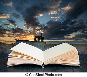 Digital composite image of Abandoned fishing boat on beach landscape at sunset coming out of pages in book