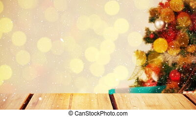 Blurred background of a living room decorated for christmas combined with falling snow