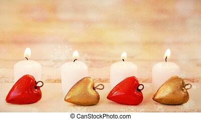 Candles and christmas decoration combined with falling snow