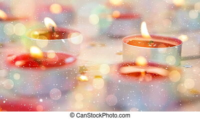 Candles combined with falling snow