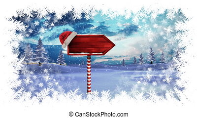 Digital composite of Christmas snowflake border with arrow sign in Winter landscape