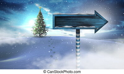 Digital composite of Christmas tree and arrow sign in Winter landscape