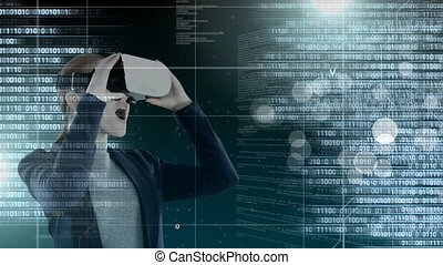 Code and technology interface with virtual reality headset on businesswoman